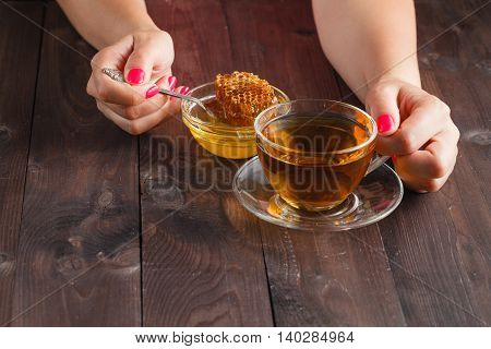 Cup Of Hot Tea In Glass Cup, Jar Of Honey, Honey Dipper On The Old Wooden Background