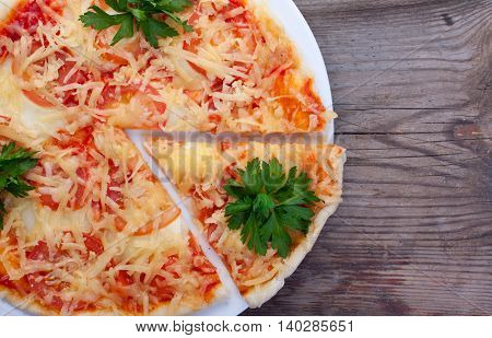 Delicious Italian Pizza On Dark Wooden Background Top View.