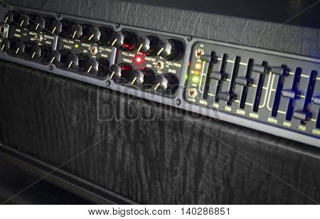 select focus close up of a guitar amplifier on stage during a live performance