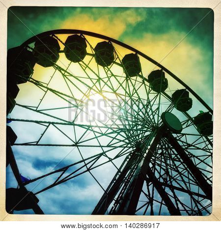 canival ferris wheel with a retro vintage instagram filter app or action