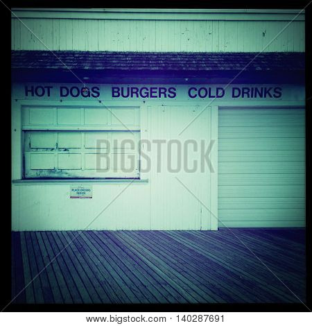 Boardwalk fast food stand closed for the winter with a retro vintage instagram filter app or action