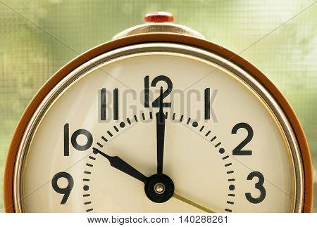 Time concept - orange alarm clock details