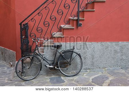 Bike parked near stairs of home in Monterosso Italy