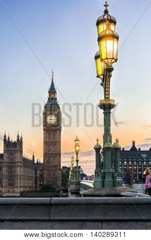 Streetlights of Westminster Bridge and Big Ben in London, at sunset