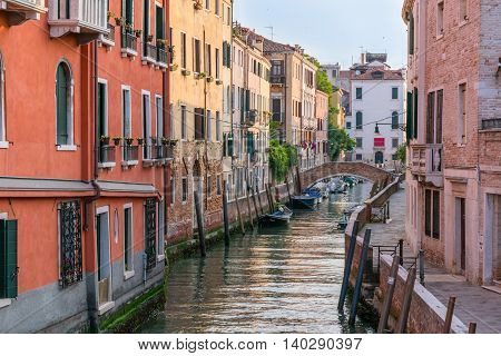 VENICE, ITALY - JULY 2: Early morning along a canal in Venice Italy.
