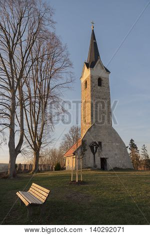 Old Village Church With Resting Bench