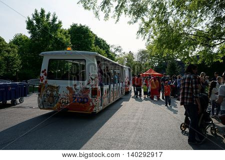 BROOKFIELD, ILLINOIS / UNITED STATES - MAY 21, 2016: Visitors to the Brookfield Zoo may board the zoo's open-air motor safari trams for a narrated tour of the zoo.