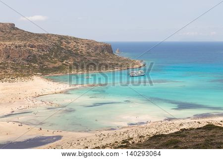 Breathtaking panorama of Balos beach and lagoon and Gramvousa island on Crete, Greece. Tourist boats mooring in lagoon.