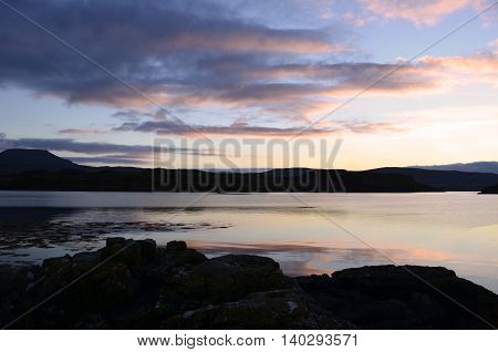 Gorgeous loch dunvegan with pink skies and water reflections.