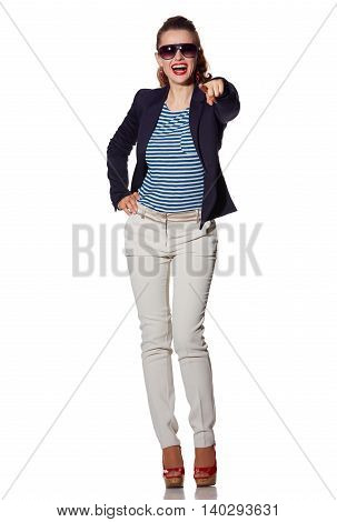 Happy Young Woman Pointing In Camera Isolated On White
