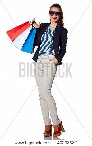 Woman With Shopping Bags In Sunglasses Posing On White