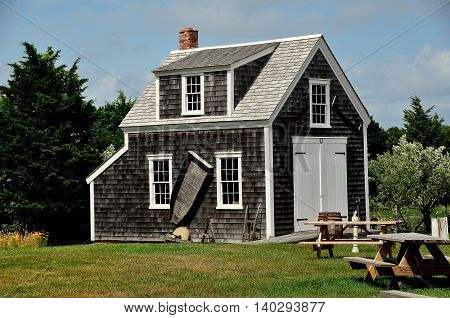 Brewster Massachusetts - July 14 2015: 1867 Henry Hopkins Blacksmith Shop at the 18th century Higgins Farm Windmill historic site on Cape Cod