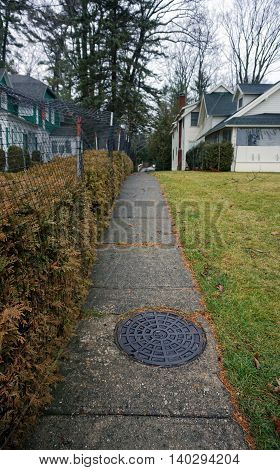 WEQUETONSING, MICHIGAN / UNITED STATES - DECEMBER 22, 2015: A sidewalk leads to homes in Wequtonsing.