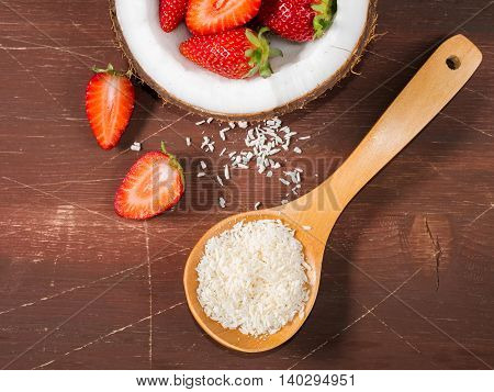 Coconut And Strawberries On Wooden Background