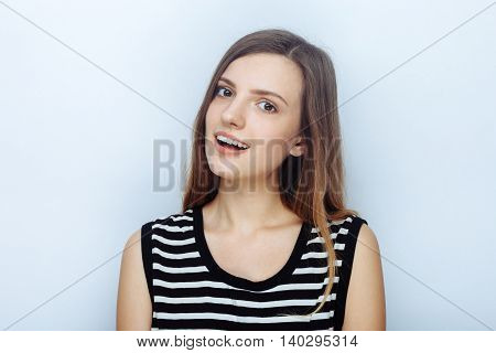 Portrait Of Happy Young Beautiful Woman In Striped Shirt Posing For Model Tests Against Studio Backg