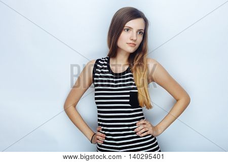 Portrait Of Happy Young Beautiful Woman In Striped Shirt Posing Hands On Hips For Model Tests Agains