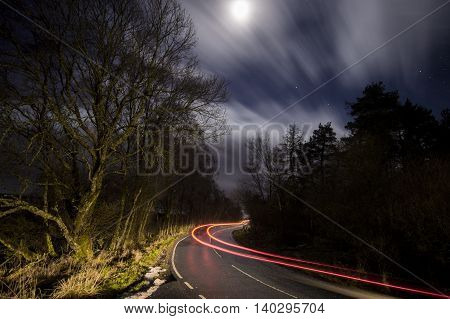 long exposure light trail on road at night