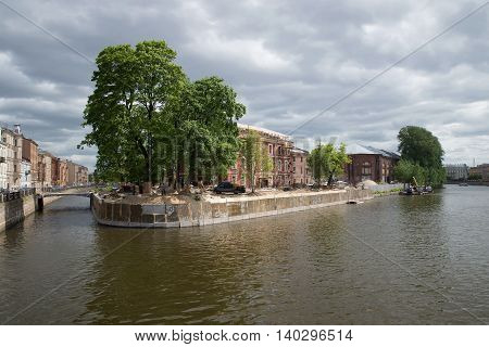 SAINT PETERSBURG, RUSSIA - JUNE 18, 2016: The renovation of New Holland. The view from the intersection of the Admiralty canal and the river Moika
