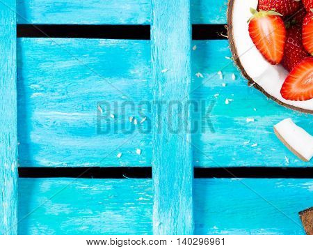 Bright Blue Background With Coconut And Strawberries