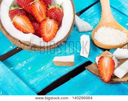 Coconut And Strawberries On Bright Blue Background