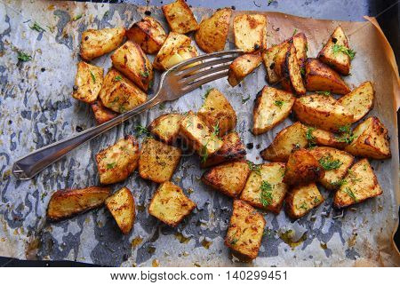 close up of the roasted potatoes  and fork