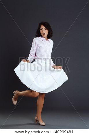 Attractive young woman posing over grey background