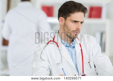 portrait of a doctor concentrating on patients results