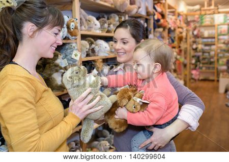 parents enjoying with their daughter in shopping mall