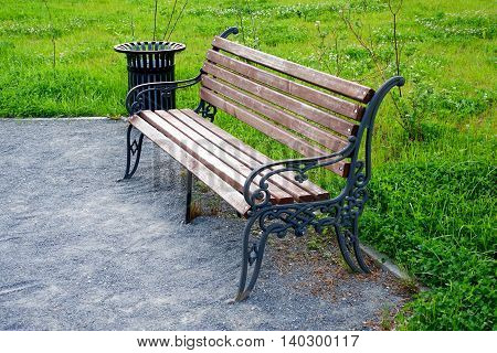 The bench is in a park at night