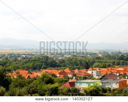 Countryside landscape, village, forest and fields during day