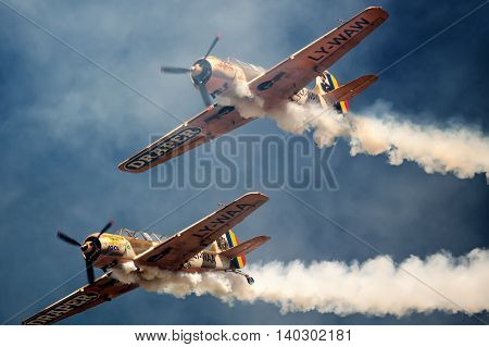 ROMANIA - JULY 23 Two unidentified vintage monoplane aircraft flying in formation at an air show on July 23 2016 in Campia Turzii Romania