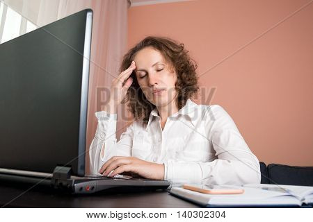Tired Woman With Headache Using Laptop