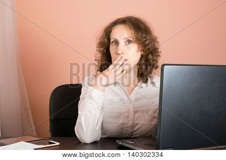 Surprised/shocked Woman Sitting In Office And Using Laptop