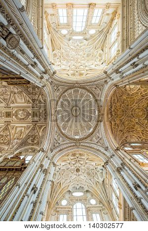 Cordoba, Andalusia, Spain - April 20, 2016: detail of the ceiling of Renaissance cathedral nave in the middle of the Great Mosque Cathedral of Cordoba.