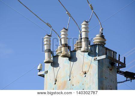 High Voltage Electricity Transformer Station Against Blue Sky