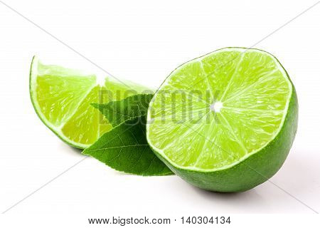 lime with slices and leaf isolated on white background.