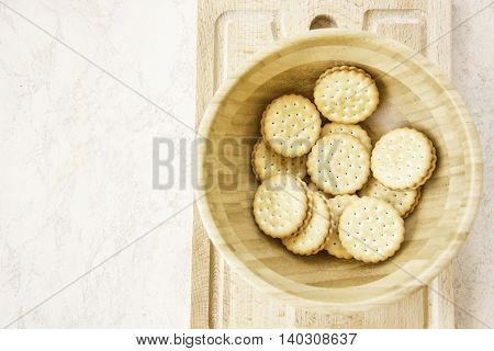 wheat sandwich cookies with chocolate filling cream round shape on wooden board top view space for text available