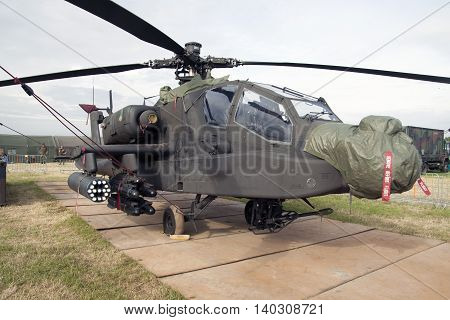 LEEUWARDEN, NETHERLANDS - JUNI 11 2016:Military Apache AH-64D combat helicopter with camouflage colors during the Air Force days