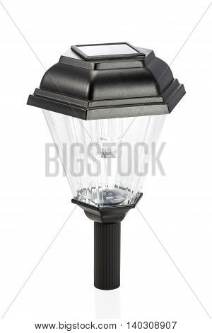 Black lantern with solar panels on top isolated on white background