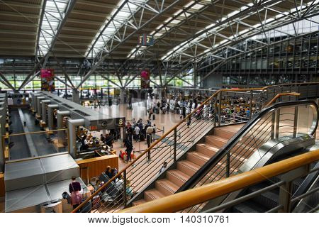 HAMBURG; GERMANY; JULY 27 2016: passenger terminal with check-in at the international airport Hamburg Fuhlsbuettel in Germany selected focus narrow depth of field