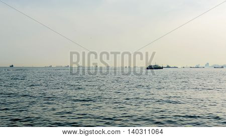 accumulation of cargo ships in the sea on the horizon during a queue waiting at the port. Panoramic view.