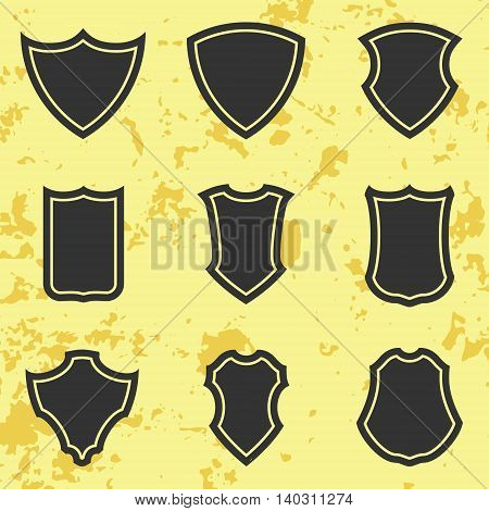 Vector heraldic shield icon set of different forms with grunge background