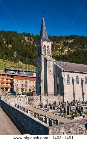 Cemetery and the stone church in the French Savoie