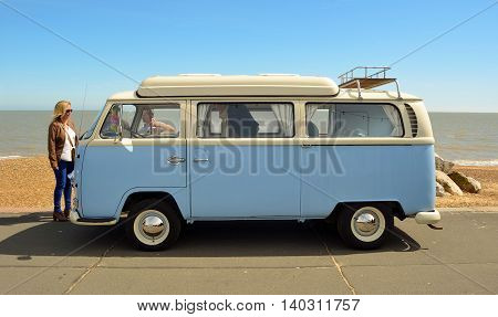 Felixstowe, Suffolk, England - May 01, 2016: Classic Blue and white Volkswagen camper van being driven along Felixstowe seafront promenade.