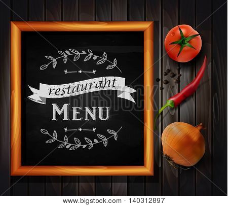 Menu on Chalkboard background with hand drawn ornament for restaurant in wooden frame on wooden background with two tomatos chili pepper and yellow onion
