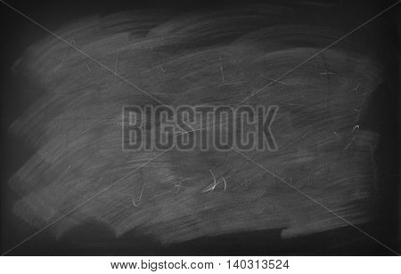 Chalk rubbed out on blackboard background