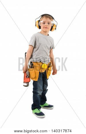 Portrait Of Boy Holding Wrench Over White Background