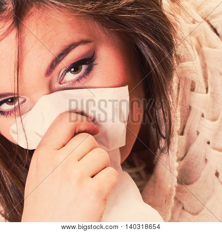 Flu cold or other virus. Sick woman girl with fever sneezing in tissue suffering from quinsy. Health care.