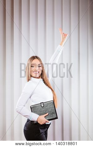 Female Office Worker Hold Case Show Victory Sign.