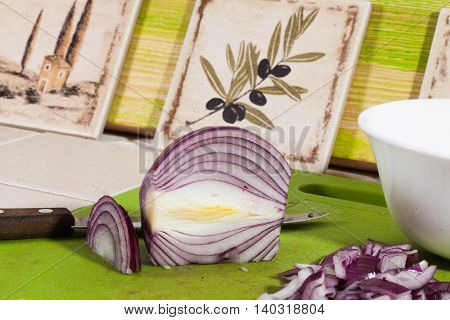 red onion sliced on the board knife kitchen cooking recipe still life